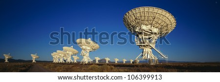 This is the Very Large Array or VLA at the National Radio Astronomy Observatory. It represents communication. - stock photo