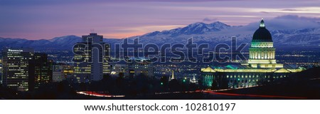 This is Utah's State Capitol, Great Salt Lake and Snow Capped Wasatch Mountains at sunset. - stock photo