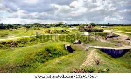This landscape is covered with deep craters from the bombardments on D-day at the coast of Normandy in france. The Battle of Pointe du Hoc - stock photo