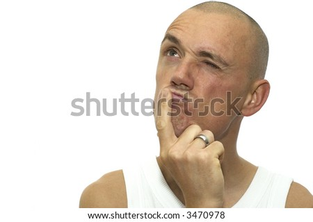 This man is thinking really hard. He is absolutely not sure if he wants to do what you asked. - stock photo