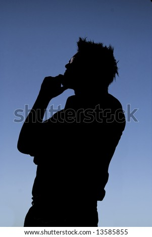 This photographic silhouette has some nice shadow detail. The figure is clearly pondering some deep thought. - stock photo
