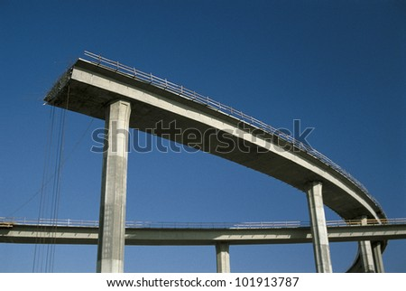This shows a freeway under construction. It is the end of the road. - stock photo