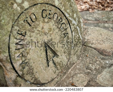 This stone marker indicates the beginning of the AT approach trail from Amicalola State Park to Springer Mountain the the full AT - stock photo