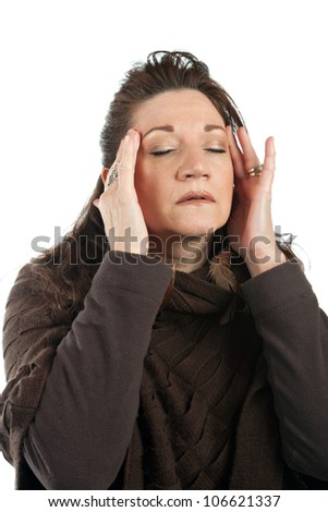 This woman has a stressed out look on her face while holding her hands on her head and temples. - stock photo