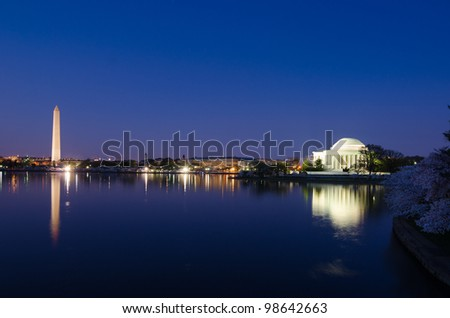 Thomas Jefferson Memorial  and Washington Monument during cherry blossom festival in Washington DC United States - Night shot - stock photo