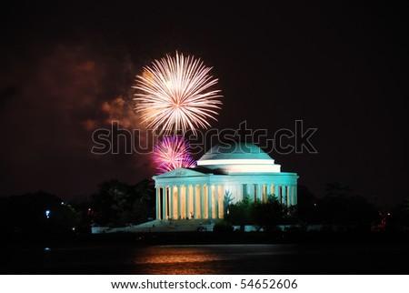 Thomas Jefferson Memorial illuminated with light and fireworks. Washington DC. - stock photo