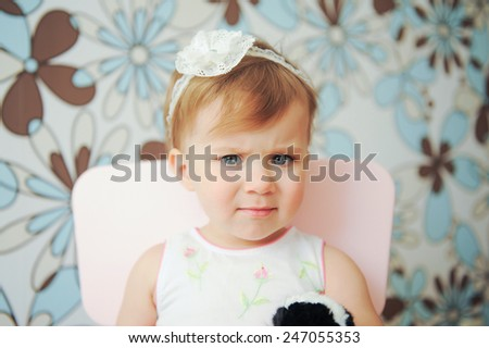 thoughgful girl sitting on chair - stock photo