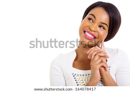 thoughtful african american woman smiling on white background - stock photo