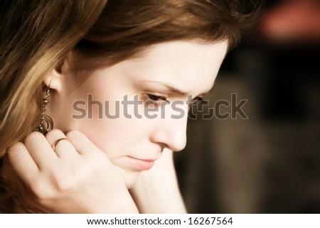 Thoughtful and sad woman portrait. - stock photo