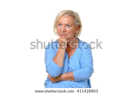 Thoughtful attractive blond elderly woman staring up into the air with her chin resting on her hand, upper body isolated on white - stock photo
