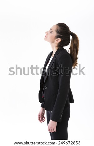 Thoughtful business woman looking up at copy space. Caucasian brunette female model. Isolated on white background.   - stock photo