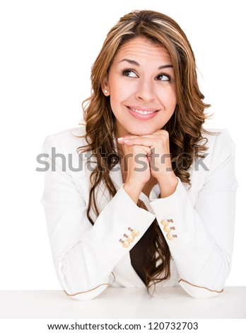 Thoughtful business woman looking up - isolated over a white background - stock photo