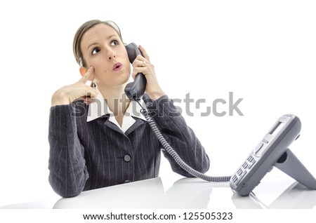 Thoughtful business woman talking on phone. - stock photo