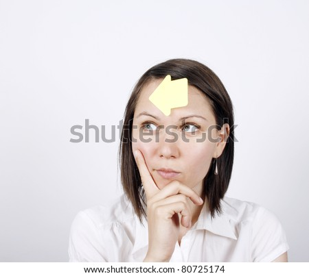 Thoughtful business woman with to do list on her forehead - stock photo