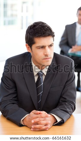 Thoughtful businessman during a meeting with a colleague at the office - stock photo