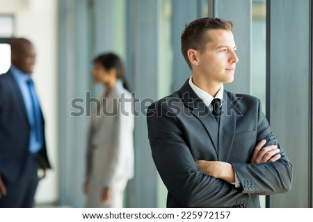 thoughtful businessman in office looking outside the window - stock photo
