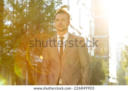 Thoughtful businessman looking away outdoors - stock photo