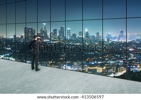 Thoughtful businessman looking into the distance in interior with concrete floor and panoramic windows with illuminated night city view. 3D Rendering - stock photo