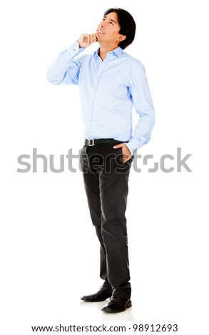 Thoughtful businessman looking up - isolated over a white background - stock photo