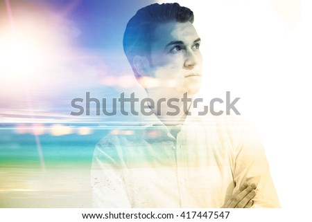 Thoughtful businessman with sunlight and seashore in the background. Double exposure - stock photo