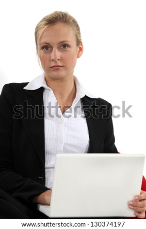 Thoughtful businesswoman with a laptop - stock photo