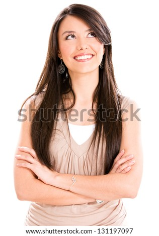 Thoughtful casual woman looking up - isolated over a white background - stock photo