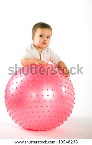 Thoughtful dark hired boy with pink fitness ball on white background - stock photo