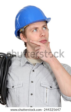 Thoughtful electrician - stock photo