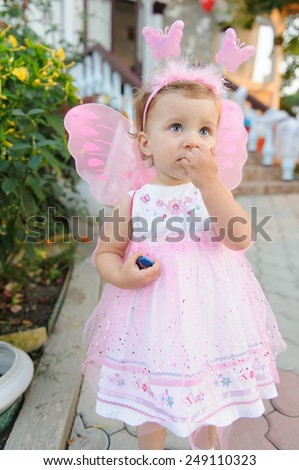 thoughtful girl in fairy dress - stock photo
