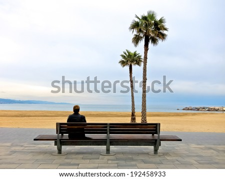 Thoughtful girl on the beach. Seascape - stock photo