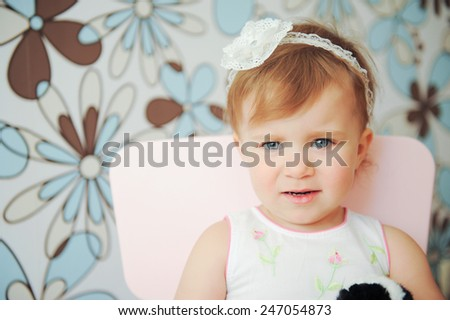thoughtful girl with opened mouth on chair - stock photo