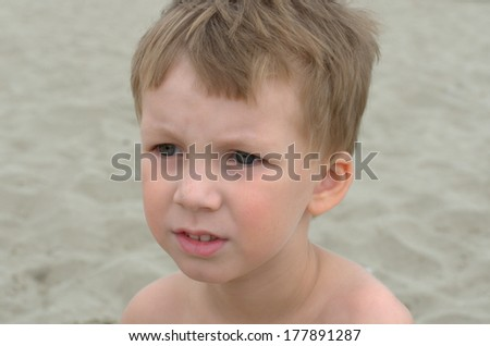 thoughtful little boy looking forward - stock photo