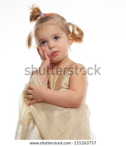 Thoughtful little girl in golden dress isolated on white  - stock photo