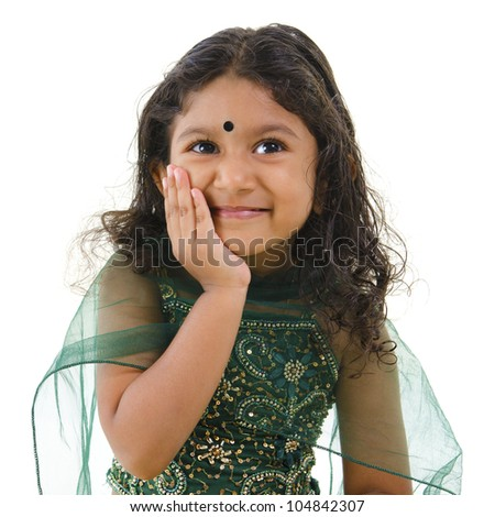 Thoughtful little Indian girl hand on chin , isolated white background - stock photo