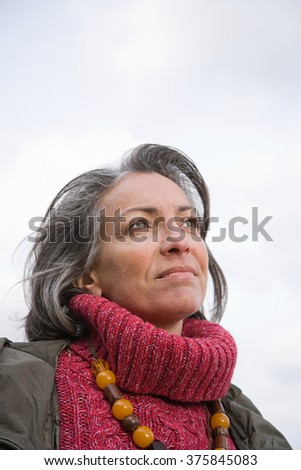 Thoughtful looking woman - stock photo