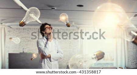 Thoughtful male doctor - stock photo
