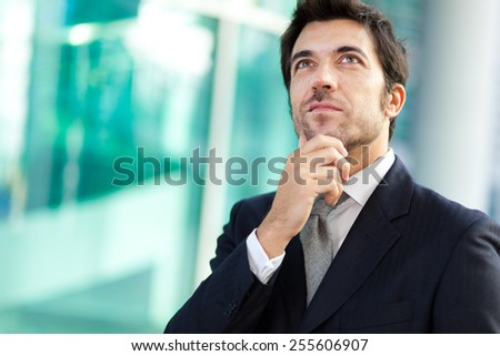 Thoughtful male manager outdoor - stock photo