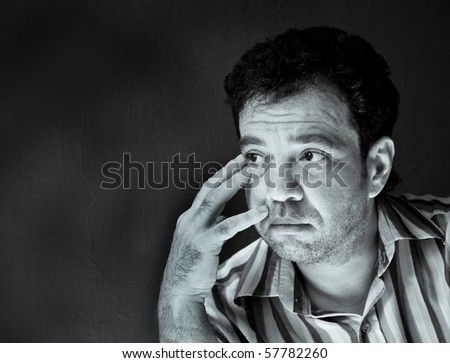 Thoughtful man. Black and white portraits series - stock photo