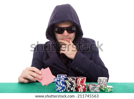 Thoughtful poker player isolated on a white background - stock photo