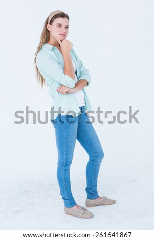 Thoughtful pretty hipster on white background - stock photo