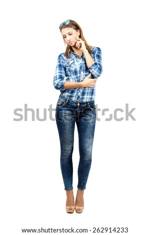 Thoughtful sad young beauty looking down. Full body length portrait isolated over white background - stock photo