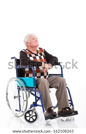 thoughtful senior man on a wheelchair looking up isolated on white - stock photo
