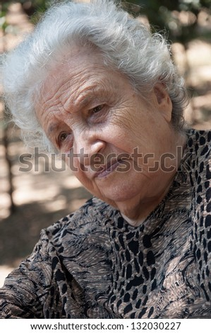 thoughtful senior woman - stock photo