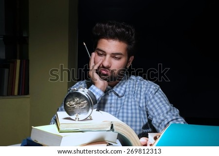 Thoughtful student studying hard for exams. - stock photo