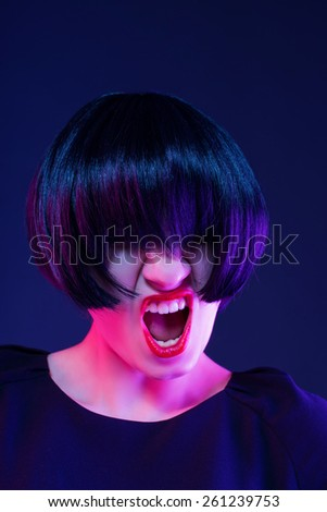 thoughtful woman in a black wig - stock photo