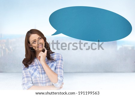 Thoughtful woman placing her finger on her chin with speech bubble against city scene in a room - stock photo