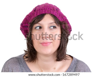 Thoughtful woman wearing a knitted purple winter cap smiling in anticipation of being able to realise her dreams, looking off with her eyes to the side and smiling, isolated on white - stock photo