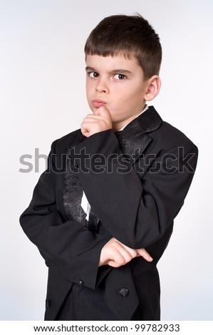 thoughtful young boy in a business suit - stock photo