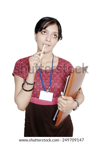 Thoughtful Young female secretary looking up. - stock photo