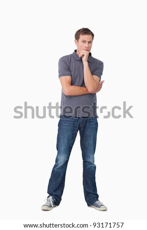 Thoughtful young man against a white background - stock photo